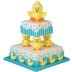 Bathtime Buddies cake. Rubber duckies shaped from fondant contribute saucy silhouettes to a multi-tiered cake.