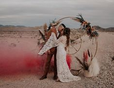 with smoke bombs and a peace sign arch, your Las Vegas wedding goes from tacky to dreamy.  bloomingbelles rentals Las Vegas wedding Inso Wedding Sparklers, Pink Smoke Bomb, Confetti Gender Reveal, Sparkler Send Off, Sparkle Wedding, Las Vegas Weddings, First Dance, Smoke Bombs