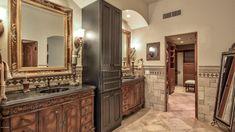 Traditional Master Bathroom with Slate counters, limestone tile floors, Wall sconce, Raised panel, Stone Tile, Limestone Tile