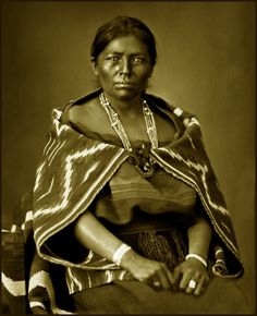 Studio portrait of Juanita, a Native American (Navajo) woman, wife of Manuelito. 1882 to 1900.