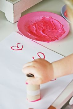 Making hearts with empty toilet paper roll.