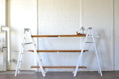 White+Ladder+Shelving: Unique and rustic shelving option that's versatile for so many uses!  Great for dessert displays and trade show booths.  *ladders may be moved closer together