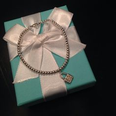 Tiffany mini beads bracelet with lock Iconic Tiffany beads bracelet with a cute mini lock in sterling silver. Lock has Tiffany logo. Item will be perfectly gift wrapped in Tiffany blue box and pouch. Size medium. It can be resized at any Tiffany store. Tiffany & Co. Jewelry Bracelets