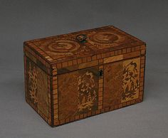 """1750-1775 British Tea caddy at the Metropolitan Museum of Art, New York - From the curators' comments: """"For the marquetry of this tea caddy, layers of lighter and darker straw were stacked and cut at the same time before being separated. That resulted in identical chinoiserie decoration, which was used with a twist: on the right, a light ground is inlaid with darker straw ornament and vice versa on the left."""""""