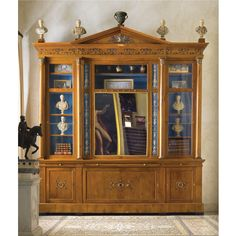 """FURNITURE FROM THE COLLECTION OF GIANNI VERSACE VILLA FONTANELLE, MOLTRASIO."": AN IMPORTANT ITALIAN GILT-AND PATINATED BRONZE-MOUNTED CHERRYWOOD BREAKFRONT BOOKCASE BY KARL ROOS, THE MOUNTS BY GIUSEPPE SPAGNA, AFTER DESIGNS BY GIUSEPPE VALADIER CIRCA 1814. Sotheby's"