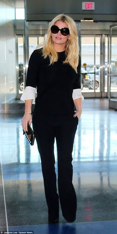 5be9359245d3 Jessica Simpson shows off her svelte figure in chic monochrome