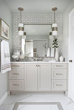 Kathleen - Kimberley Giancaterino Interiors - Elegant bathroom design using #crystorama lighting. Glass and marble backsplash tile. Custom mirror. Beveled shaker vanity and porcelain tile flooring.