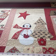 Quilted wind and snow! Fabulous!!  First time I have done one of these and I am not sure if I am supposed to quilt the Snowman or just stitch in the ditch and secure with invisible thread? What do other quilters do? #christmasquilt #aurifil #customquilting #clientquilt #freemotionquilting #freebirdquilting