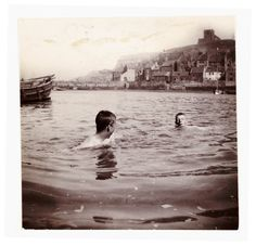 Two boys swimming in Whitby Harbour, North Yorkshire, c 1902. Frank Meadow Sutcliffe