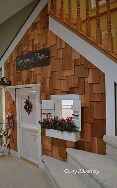 A playroom cottage underneath the stairs... Woah I wish I had this as a kid in our basement!!