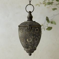 "A charming accent around the house, this antiqued lantern is hand-crafted from durable iron with a glass votive hurricane inside.- Iron, antiqued finish- Indoor use recommended - Hanging chain: 11""- Imported10.25""H, 5.3""W, 5.7""L"