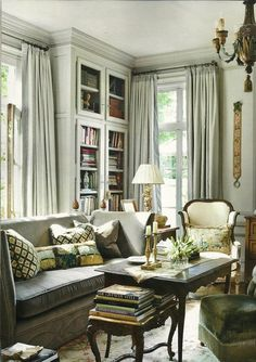 Elegant Interiors: I like the built in shelves with glass. This whole space is lovely.