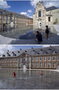 Averbode Abbey square, province of Brabant, Belgium. Only a few centimeters deep, the shallow pool reflects a ring of buildings like the baroque church. The 5,000 square meter area facilitates runoff from rain events like a giant puddle.