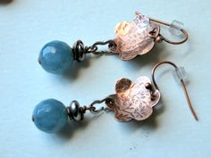 Forget-me-not Flower textured Copper with Smoke Baby Blue and gun metal drops by Bandana Girl Milled textured concave copper flowers with Czech glass beads ...so sweet and look great with everything! Antique copper finish on french earwire  Feeling blue about the cold weather...there is hope with one of the seasons first blooming flowers.  Forget-me-not's :) Look for matching forget-me-not necklace in my line.