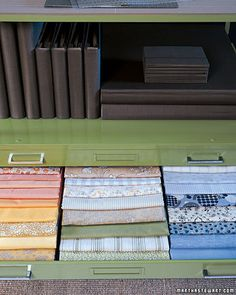Organizers for Paper and Fabric:   Flat-file drawers house fabrics and papers sorted by color and type -- in this case, cotton fabrics, both vintage and new, which Martha buys whenever she spots ones she likes.