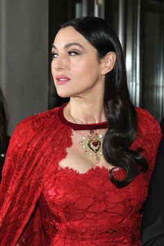 Pin for Later: The Prettiest Met Gala Shots Need to Be Zoomed In Met Gala Red Carpet Details 2014 It was a definite Red Riding Hood vibe for Monica Bellucci, who picked a luxe choker and lace cape that circled her neck.