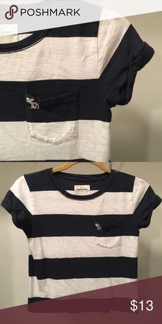 Navy & White Striped Crop Top Super cute striped crop top from Abercrombie Kids. I've had this shirt for the past 3 years & even though it is a Kids Large it still fits me (I wear an adult XS or S and have a 32C bra size) without showing much of my stomach at all even though it is a crop top. I love to wear with white shorts! Gently worn, no stains or holes. *smoke free home* *price negotiable- make an offer!* abercrombie kids Tops Crop Tops