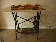 Old White USA treadle sewing machine legs and a spare floor tile make a nice table.