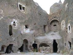Houses carved into tufa rock, Cappadocia, Turkey
