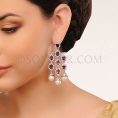 EAR/1/3413 Earrings in silver rhodium finish studded with cubic zircons and amethysts czee stones  $98	 £58