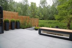 Rosemary Coldstream used our Blue Grey Granite paving in her award winning design, contrasting its charcoal grey colouring with black accessories to create a secluded relaxing garden. Granite Paving, Riverside Garden, Patio Slabs, Stone Landscaping, Garden Paving, Front Yard Design, Modern Pools, Outdoor Seating Areas, Metal Pergola