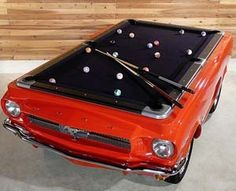 Soo cool for the basement! Play a game of billiards on one of the greatest pony cars to ever grace the auto industry – the 1965 Ford Mustang. These custom made Mustang Pool Tables comes with real chrome bumpers, working head lights, real tires, and real wheels.