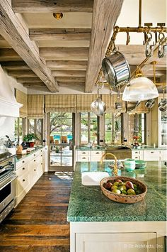 Modern Country Kitchen. Gorgeous kitchen with white cabinetry, granite tops, rustic beams, gorgeous rich wood flooring. Oz Architects