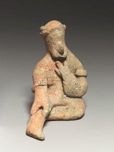 Seated male figurine.  Terracotta, Cypriot culture. Cypro-Archaeic period (ca. 600-480 B.C.).  (Source: Metropolitan Museum of Art)