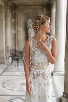 The gold and silver beading and embroidery on this 20's inspired dress is perfect for a #Gatsby themed wedding. | The Hottest Wedding Dress Trends of 2015
