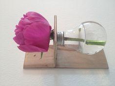 Light bulb vase with pink flower