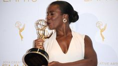 thechanelmuse:  Congratulations to Uzo Aduba for scoring her first Emmy! Uzo Aduba who plays Suzanne 'Crazy Eyes' Warren on Orange Is The New Black won a Creative Arts Emmy for her Outstanding Guest Actress. Joe Morton who plays Rowan Pope onScandalwon aCreative Arts Emmy for Outstanding Guest Actor.