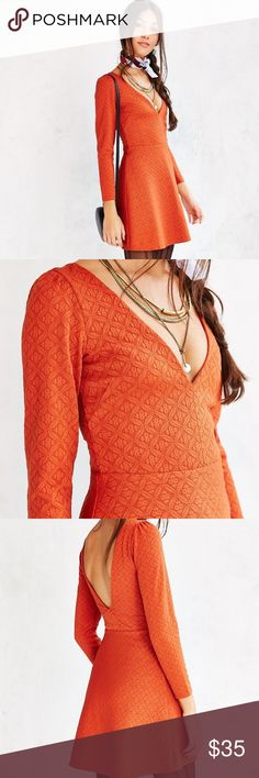 Urban Outfitters Cooperative plunging knit dress! Urban Outfitters Cooperative plunging knit dress-NWT! This fit and flare SILHOUTTE is cut short with long sleeves and deep v back. Made from polyester/spandex. Machine wash. Sold out in stores! Urban Outfitters Dresses