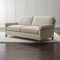 Shop Montclair Apartment Sofa.   Soft but supportive cushions are upholstered in a subtly textured cotton-linen fabric detailed with smart self-welting for a crisp, fresh finish.  Montclair Apartment Sofa is a Crate and Barrel exclusive.