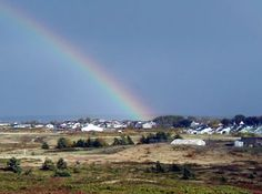 Rainbow over the town of Inverness, Cape Breton Island, Nova Scotia Canada.