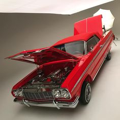We got this #lsxr powered convertible from #Cleveland in the studio today #1964impala #lowridermagazine