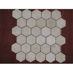 Hexagon 2x2 TUMBLE Light Beige Travertine Mosaics/floor tile?  honeycomb tile shape- perhaps the pattern is the most defining factor in a home rather than the type of materials?