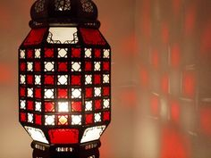 700mm high x 250mm wide.  A beautiful large oxidized tin lantern with glass panes handcrafted in Marrakech, Morocco. Puts out a beautiful filigree pattern if you use a clear light bulb. Has panes of white & red glass.  Does not include any electrical fittings.  Ceiling roses with hook available online. Moroccan Lighting, Moroccan Lanterns, Moroccan Decor, Moroccan Style, Clear Light Bulbs, Electrical Fittings, Marrakech Morocco, Ceiling Rose, Arabian Nights