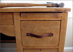 Replace drawer pulls with cut-up leather belts. Great for a worn industrial look.