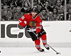 Beautiful Spotlight photo featuring Blackhawks forward Patrick Kane  * This photo is available in sizes 8x10, 11x14, 16x20 (choose your size from the drop down box at the top right)  * The photo has been digitally retouched to create a unique color image on a black & white background, then reproduced on an Epson Stylus Professional 3880 with K3 Ultrachrome Color Technology, using thick stock, professional satin luster paper, providing archival longevity and image quality, eye-popping color…