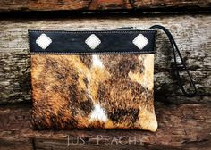 The talented artisans at LJ Collection use only the finest leathers and hides when creating each of their pieces. Each piece is thoughtfully hand-crafted in California. This one-of-a-kind wristlet/clu