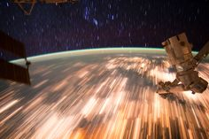 Long exposure image shows Earth lights and star trails from low Earth orbit