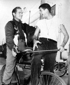 Bob Hope and Jerry Lewis ride a bike.