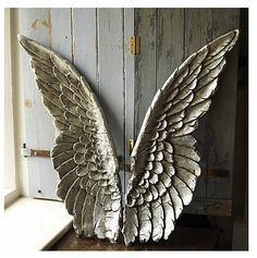 Angel wings.   Would love to find something like this for decoration