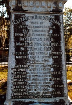 """TALLAHASSEE'S WITCH GRAVE A century old legend surrounds a curious tomb in Tallahassee's old City Cemetery. As I entered the iron gates of the cemetery my attention was captured by an ornate, towering obelisk marking a curious tomb. It's easy to get the feeling that this unusual grave magnetically beckons visitors to come closer. This is the most visited grave in the entire cemetery, mainly due to a legend about how it's the final resting place for a witch named """"Bessie."""""""