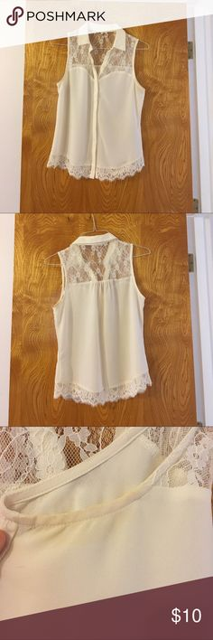 Cute lace/sheer white sleeveless top. White/cream top with lace paneling. Sleeveless and has a small collar. Polyester. Size medium. It has a small pit stain that I wasn't able to get out. Tops Button Down Shirts