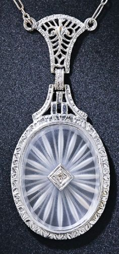 Vintage Frosted Crystal and Diamond Necklace. This lovely, romantic pendant necklace features a framed oval frosted crystal or camphor glass accented with a sparkling diamond. circa 1930