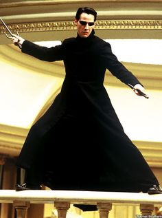 """""""The Matrix Reloaded""""  Best scene right here: the fight in the hall of weapons.  Seriously, in what other sci-fi movie do you get to use sais, maces, axes, European and Asian weapons- and all while rocking sunglasses and a trench coat?"""