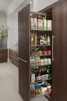 Tall pull-out pantry, as shown in the Modern History kitchen by #WoodMode.