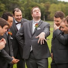 The groom 'showing off' his ring. ;)