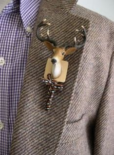 Deer Boutonniere ... I love deer 'n I love country ... but not only is this thing wayyyy to big, it is one ugly lookin' buck!!
